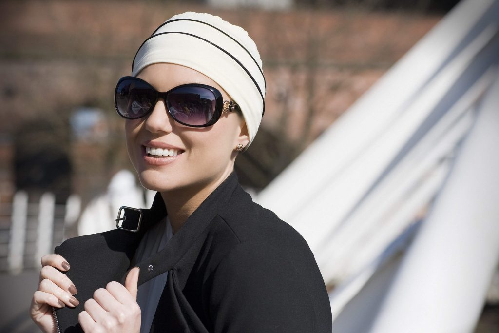 Cancer headwear UK Brooklyn A woman wearing white chemo cap with black  piping details A woman wearing white chemo cap with black piping details ... 902180193fe6