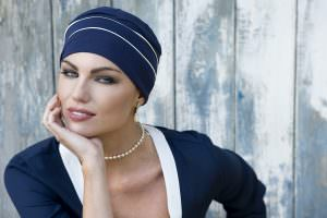 woman wearing navy chemo cap with white piping details