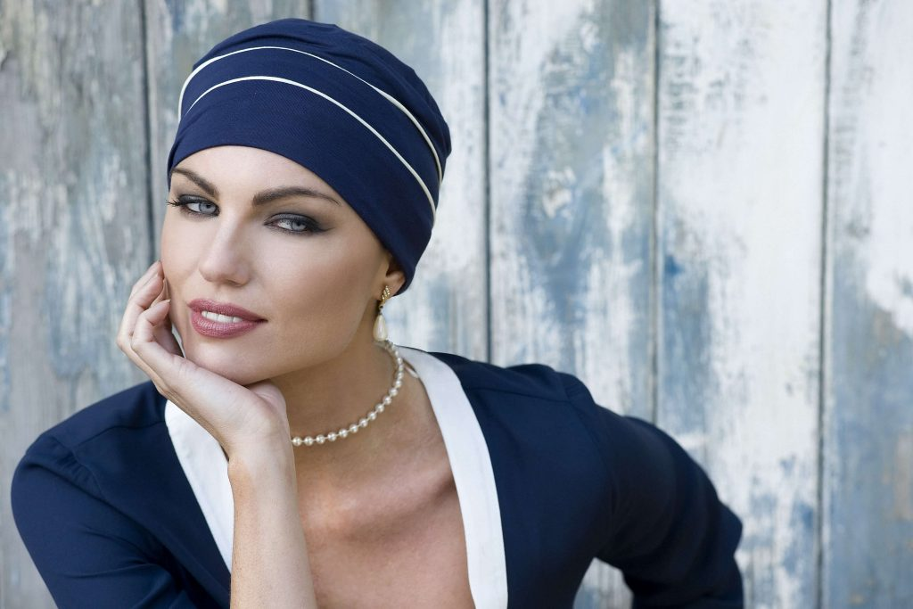 ... black piping details woman wearing navy chemo cap with white piping  details ... 029803b61a70