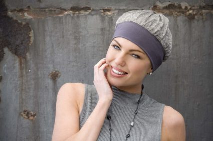 Woman wearing grey hat with granite effect