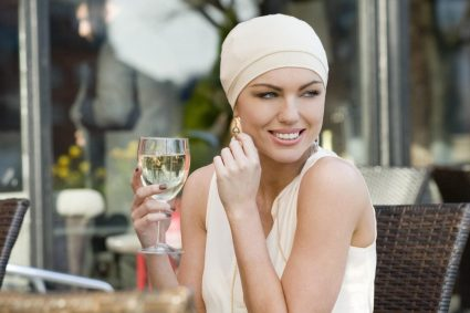 woman wearing simple nude chemo hat