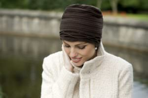 woman wearing cosy brown chemo hat