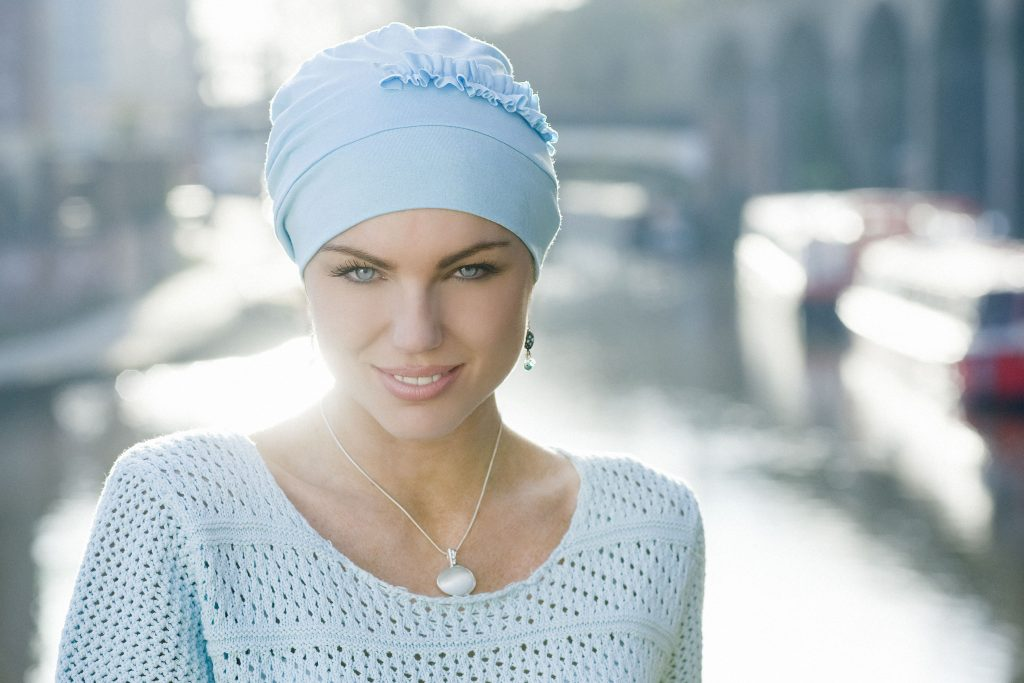 woman wearing baby blue chemo hat front