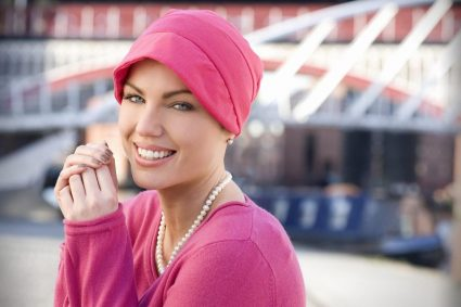 Woman wearing hot pink cap with extended front section