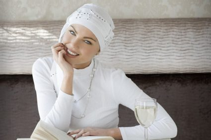 Stylish chemo headwear Yanna white spiral Woman wearing white sophisticated headwear