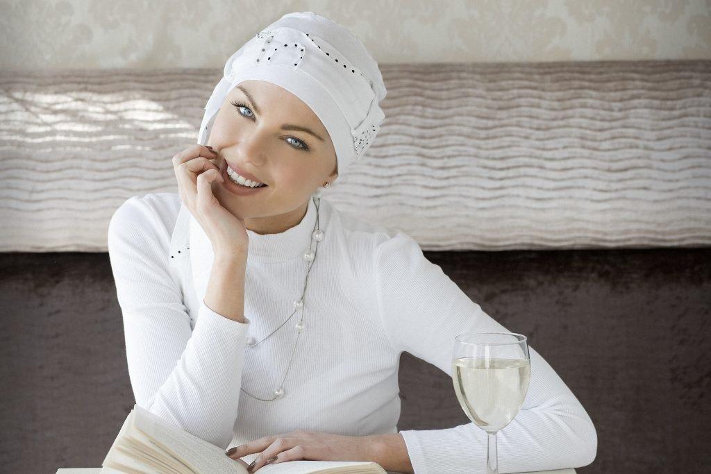 Stylish chemo headwear Yanna white spiral Woman wearing white sophisticated headwear
