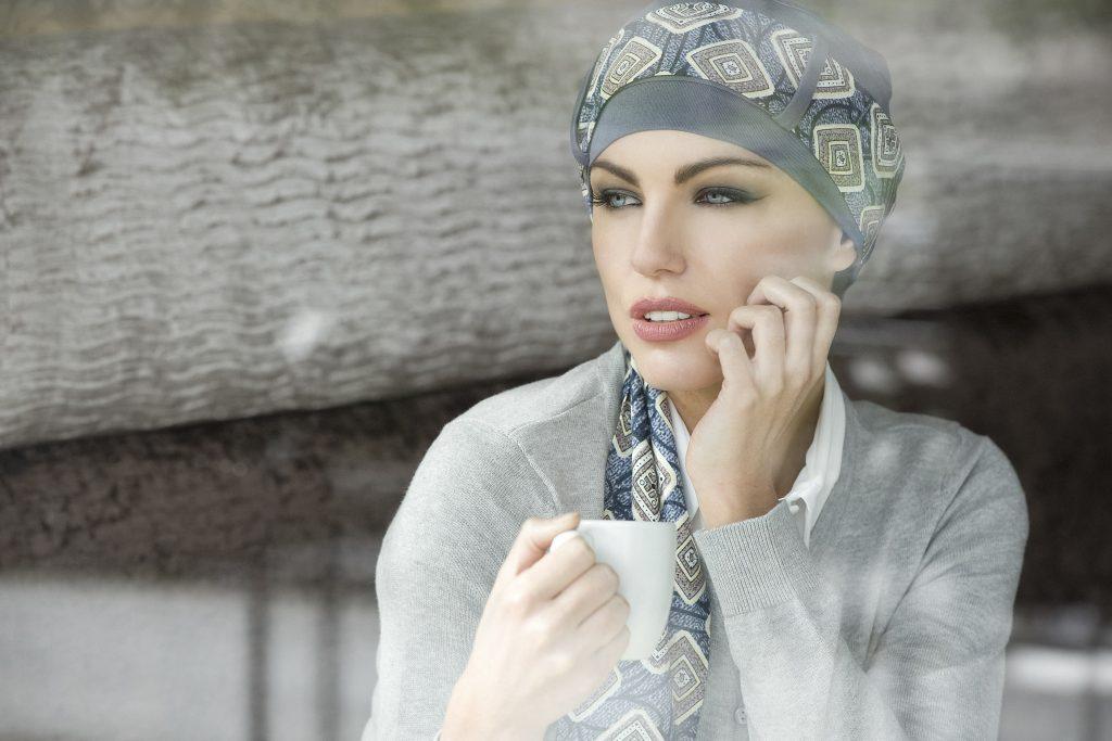 woman wearing grey patterned chemo headwear