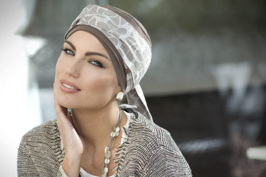 Woman wearing taupe chemo headscarf