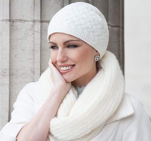 Woman wearing a soft white knitted Basketweave Stitch hat