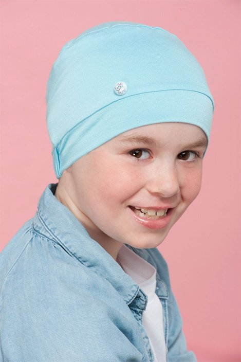 boy wearing blue chemotherapy cap