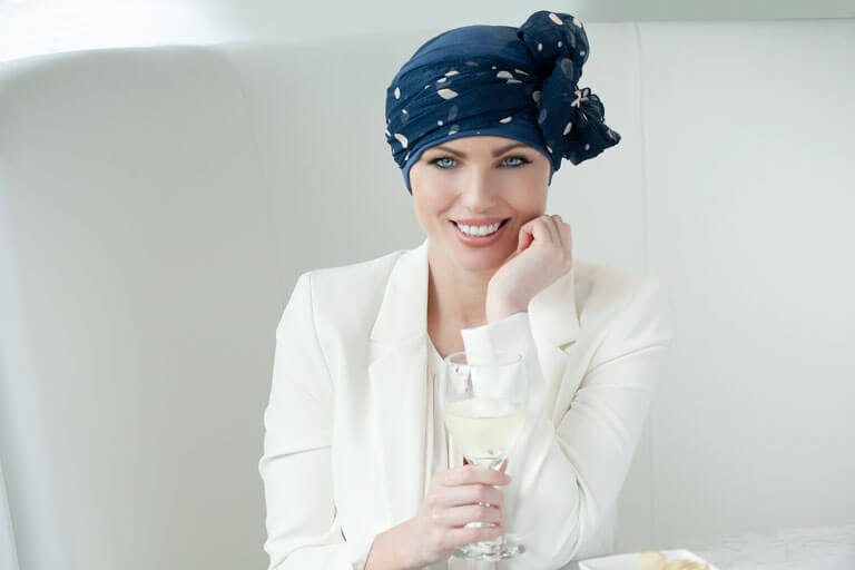 Chemo head scarves - Daisy Navy Blue Polka Dot Woman wearing Navy chemo hat with polka dot scarf tied around.