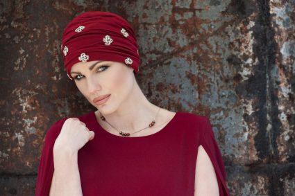 Woman wearing red embellished headwear