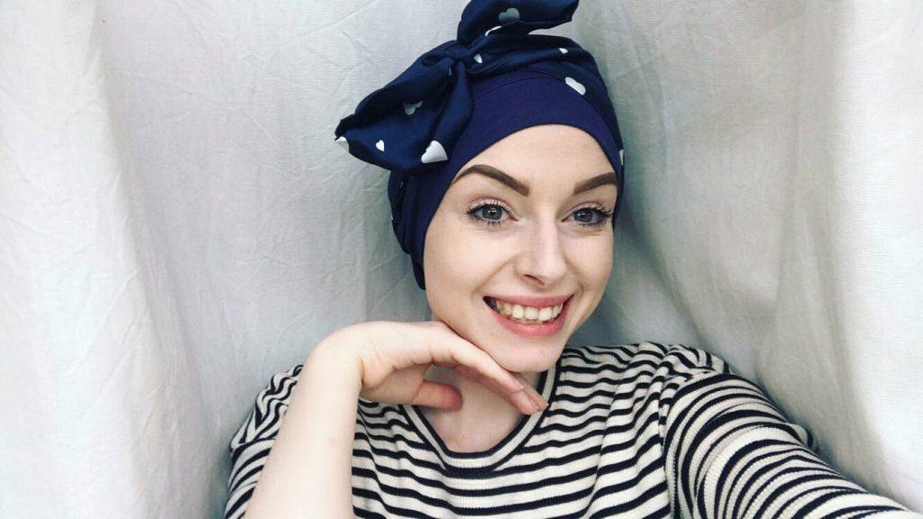 Woman wearing Masumi Headwear headscarf