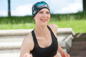 Sporty woman wearing a black and Electric Green wavy patterned headwear