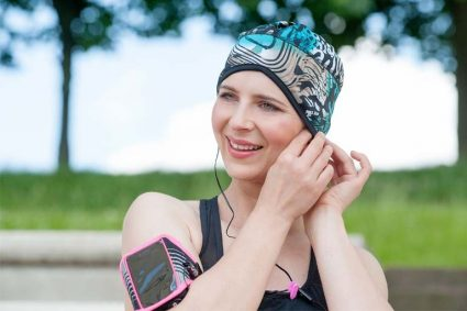 Sporty woman wearing a black and Electric Green wavy patterned headwear