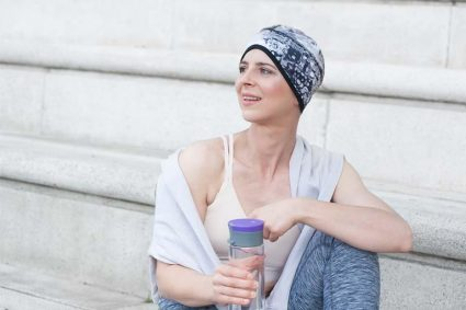 Sporty woman wearing a white and grey watermark printed headwear