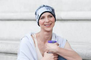 Sport chemo hat Infinity Intense Grey Sporty woman wearing a white and grey watermark printed headwear
