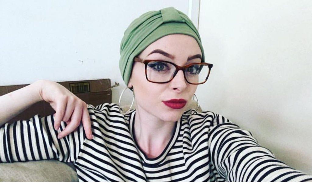 Rebecca wearing Ellie Green headwear