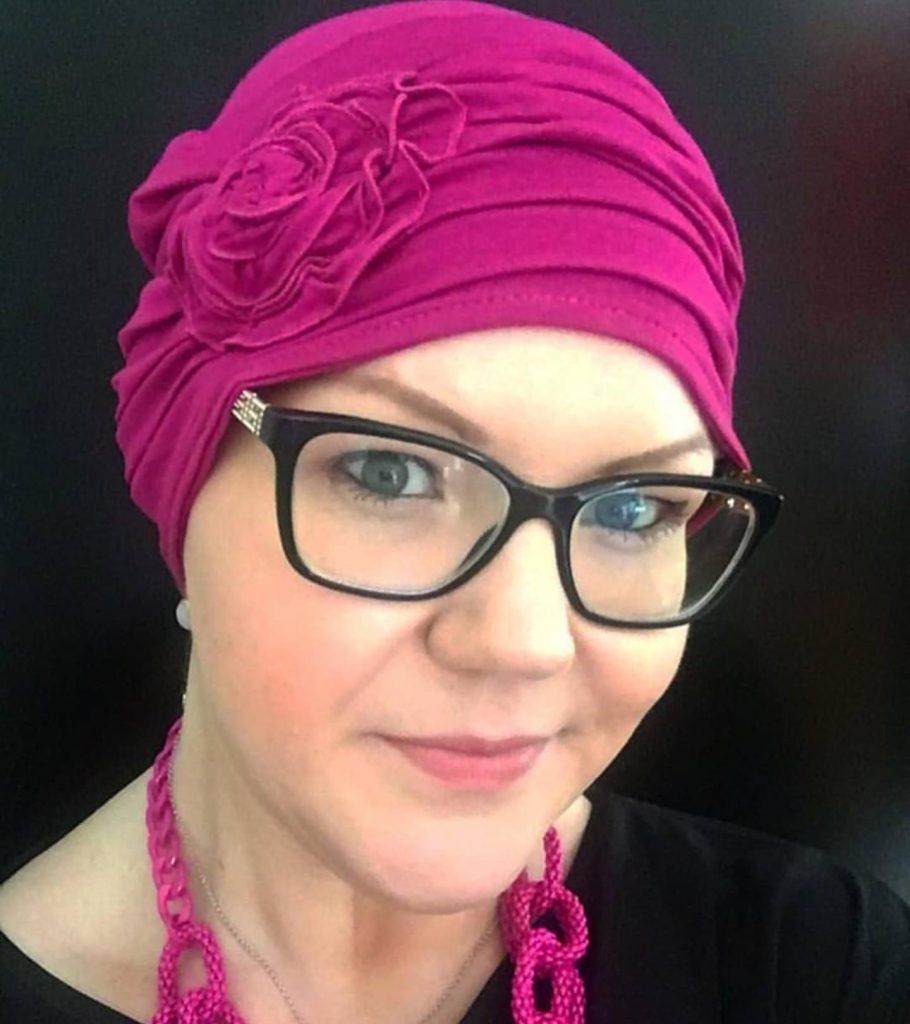 Becky wearing Primrose Purple chemo headwear