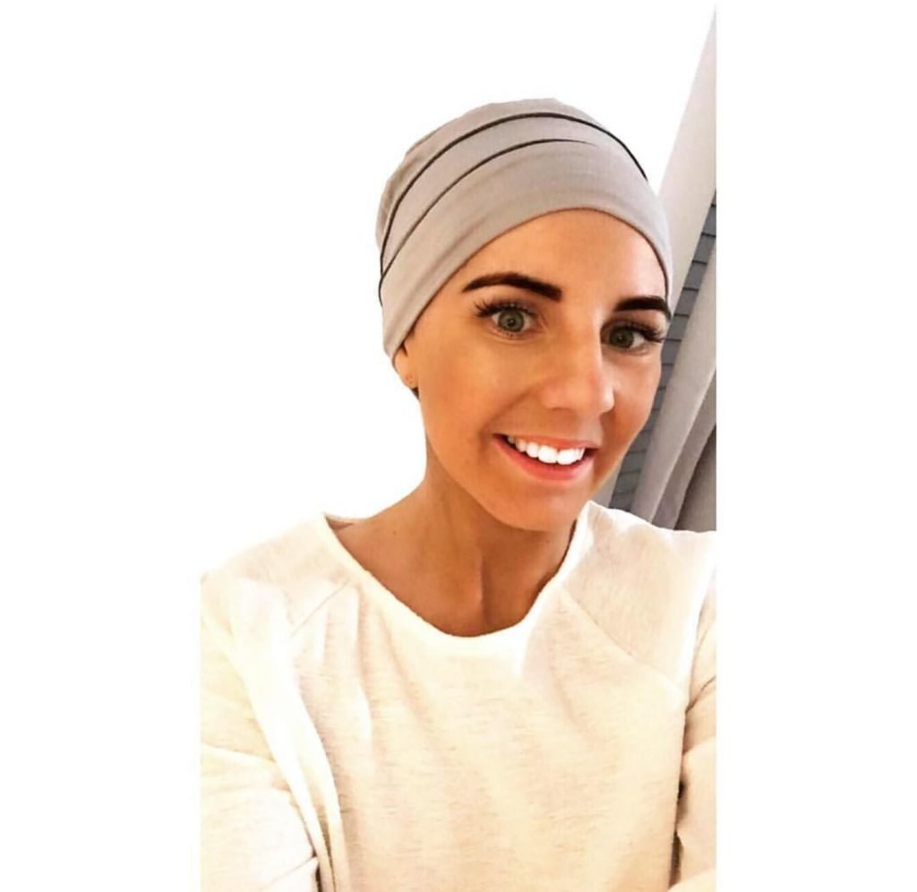 woman wearing brooklyn silver and grey headwear