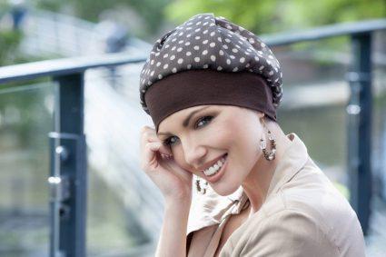 Woman wearing Brown polka dot hat