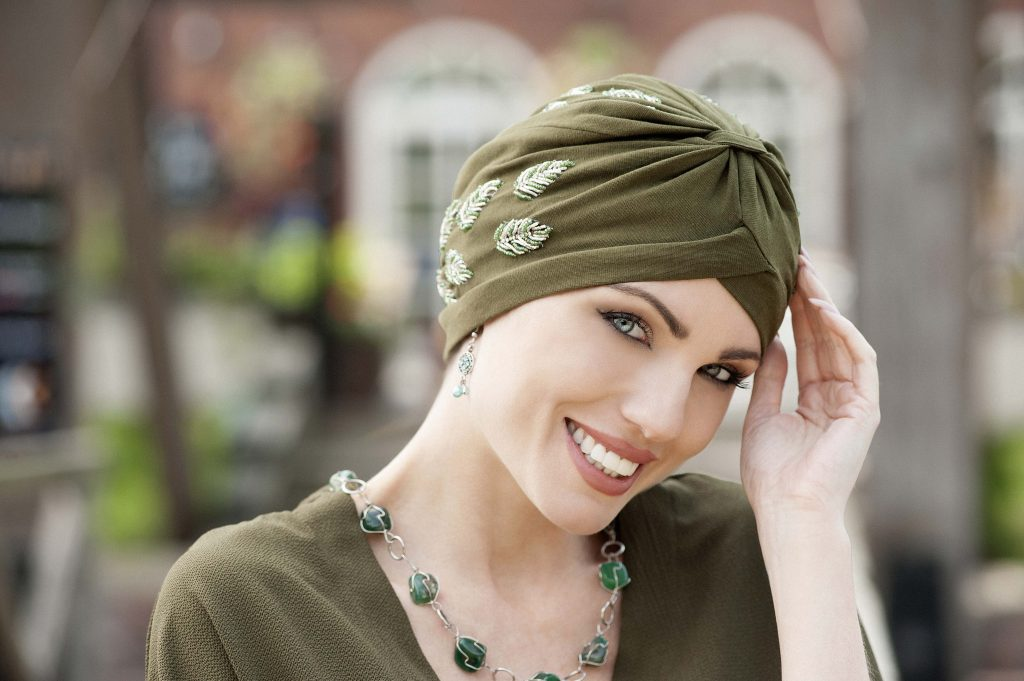 Woman wearing funky chemo headwear - green embellished soft cotton chemo  headwear with golden and green 0845941e0f5