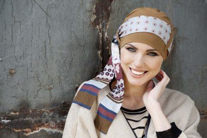 Bamboo Headwear for chemo patient Yanna Camel Sky Fiori Woman in camel colour bamboo chemo hat with sky floral patterned scarf around the headwear