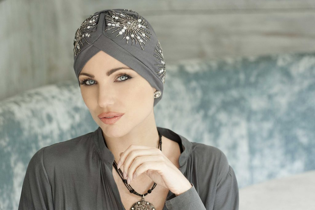 A woman in grey top wearing a hat for Cancer Patients - Gem Crystal Grey