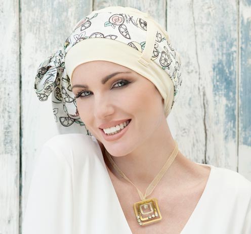 Woman wearing Yellow Chemo hat with Lemon Prints.
